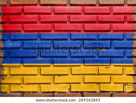 Armenia flag painted on  brown brick wall background - stock photo