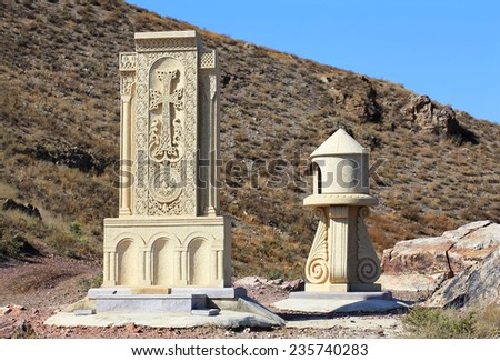 Armenian architectural monument, which is a stone style with carved image of the cross - stock photo