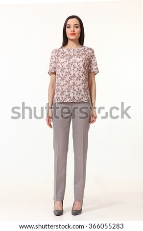 armenian asian eastern brunette business executive woman with straight hair style in printed blouse and trousers high heels shoes full length body portrait standing isolated on white - stock photo