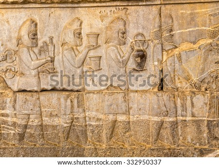 Armenian tribute relief detail on the stairway facade of the Apadana at the old city Persepolis. - stock photo