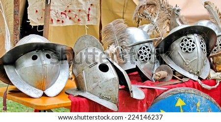 armor and helmets of ancient Roman origin and medieval helmets of brave knights and soldiers - stock photo