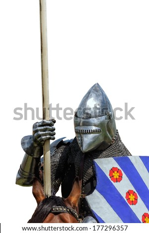 Armoured knight on warhorse with shield and lance isolated on white - stock photo