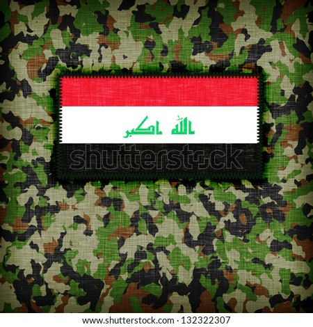 Army camouflage uniform with flag on it, Iraq - stock photo