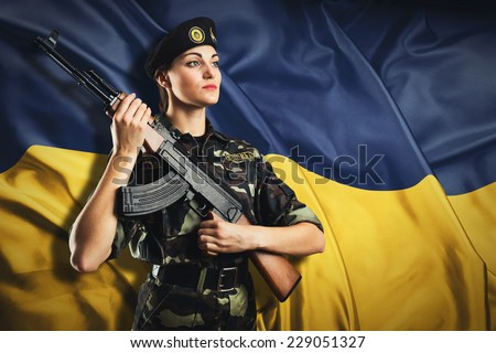 Army girl in military uniform - stock photo