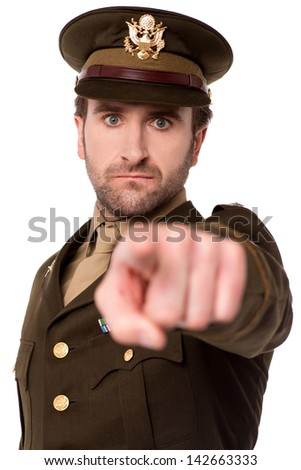 Army man in uniform pointing finger at you - stock photo
