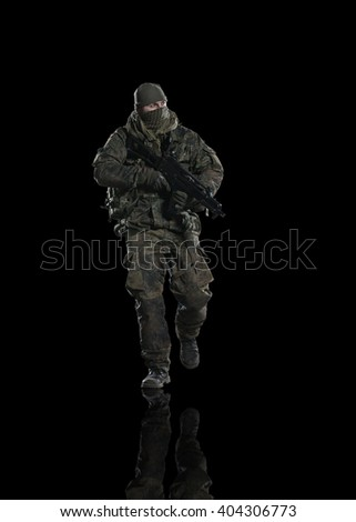 Army soldier. Studio shooting. frontal pose. going. with reflections. isolated. - stock photo