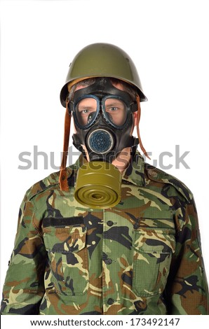 Army Soldier with Green Helmet And Gas Mask - stock photo