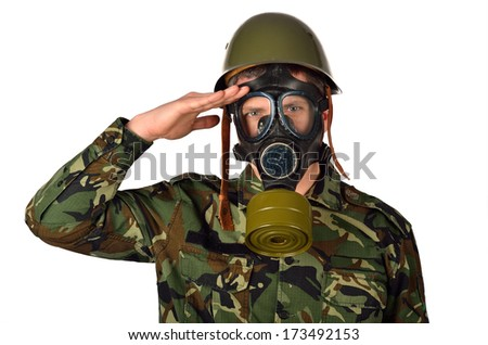 Army Soldier with Green Helmet And Gas Mask Giving Salute - stock photo