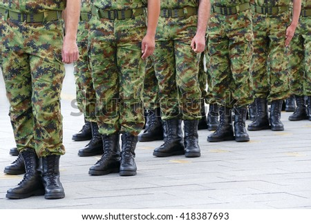 Army - Soldiers standing in line - stock photo