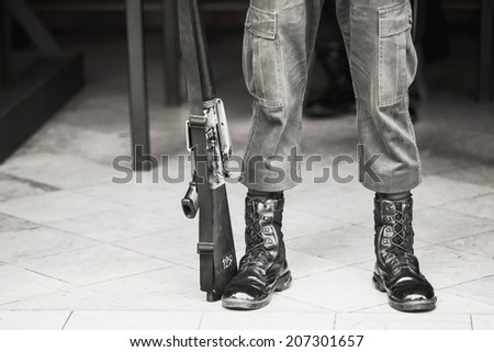 Army standing - boots close-up - stock photo