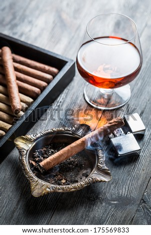Aroma of cognac and burnig cigar - stock photo