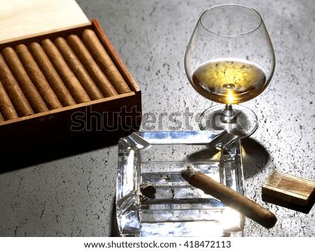 Aroma of cognac and burnig cigar - stock photo