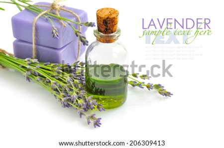 Aroma oil and handmade soap with lavender flowers - stock photo