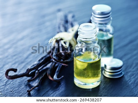 aroma oil in glass bottle, vanilla oil - stock photo
