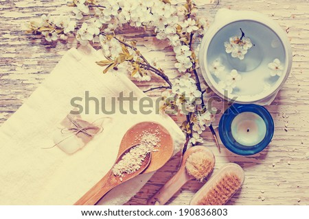 Aroma spa set on white wooden table with cherry flowers - stock photo