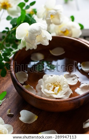 Aroma spa set with white roses, selective focus, vertical - stock photo