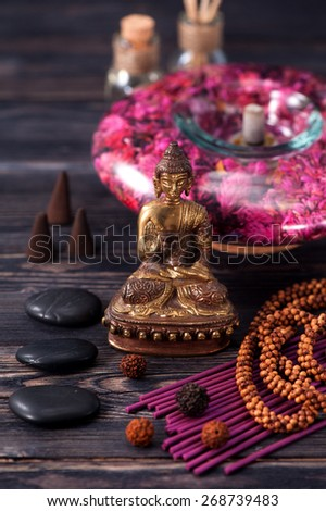 aromatherapy and spa. Buddha statue, stone massage and incense sticks - stock photo