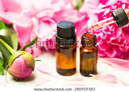 Aromatherapy, essentials oils, peony flowers - stock photo