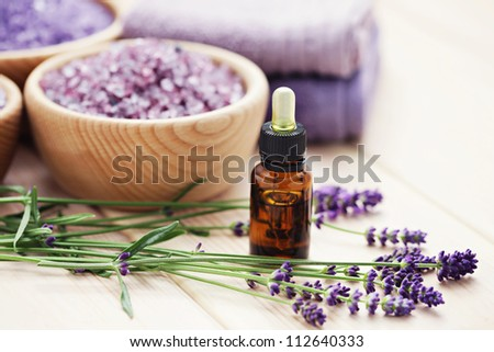 aromatherapy oil andbowl of lavender bath salt - beauty treatment - stock photo