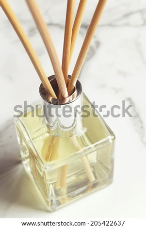 Aromatherapy reed diffuser air freshener bottle close up - stock photo