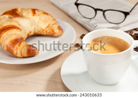 Aromatic breakfast with classical reading matter - stock photo