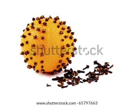 Aromatic Christmas orange with cloves on white background - stock photo