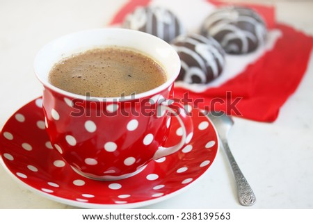 Aromatic coffee with milk in a red cup - stock photo