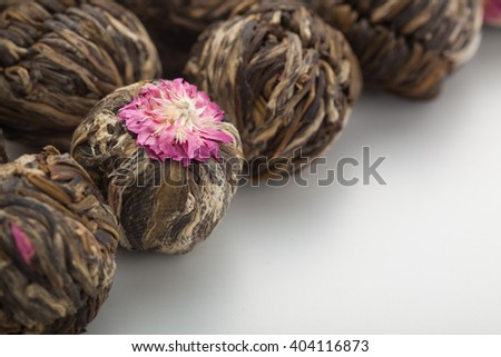 Aromatic flower green chinese tea or blooming tea on studio background - stock photo