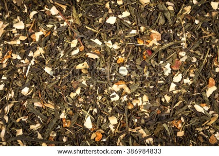 aromatic green dry tea with fruits and petals  - stock photo