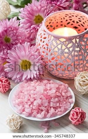 Aromatic sea salt, aroma candle and chrysanthemum flowers/Aromatic sea salt  - stock photo
