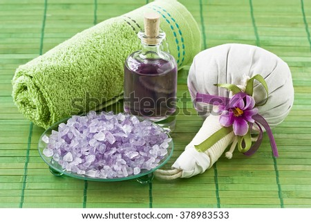 Aromatic sea salt, essential oil, herbal bag and towel for Thai massage and relax/Aroma SPA set   - stock photo