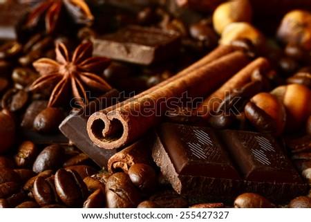 Aromatic set of chocolate,coffee,anise and cinnamon on linen - stock photo