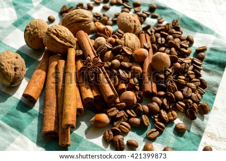 Aromatic set of chocolate,coffee,anise and cinnamon on linen.Spices for christmas cakes cinnamon sticks anise stars and cloves .Different Kinds of Spices - stock photo