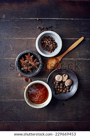 Aromatic spices and honey for Christmas cake - stock photo