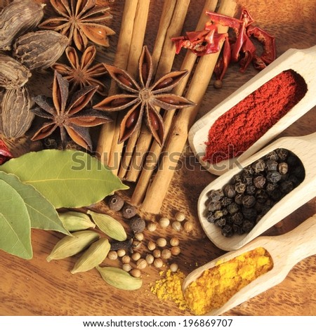 Aromatic spices. Cooking ingredients: allspice, cardamom, cinnamon sticks, clove and star anise. - stock photo