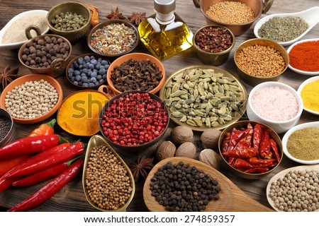 Aromatic spices in metal and ceramic bowls. - stock photo