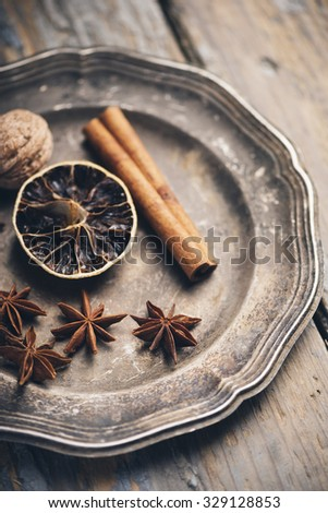 Aromatic spices in rustic silver plate. Winter christmas concept. - stock photo