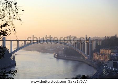 Arrabida arch bridge across river Douro, Porto, Portugal - stock photo