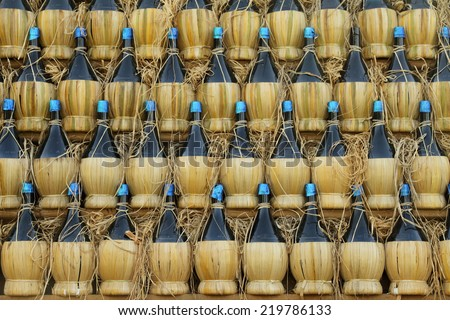 arranged many  chianti bottles in traditional pyramid on cart  , Florence, Tuscany, Italy, Europe - stock photo