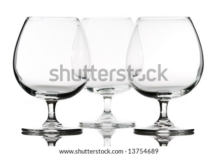Arrangement of brandy glasses over white background - stock photo