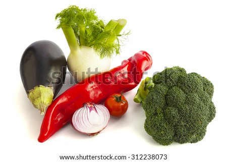 Arrangement of fresh organic vegetables including broccoli, fennel, tomato, onion, pepper and eggplant. Isolated on white background. - stock photo