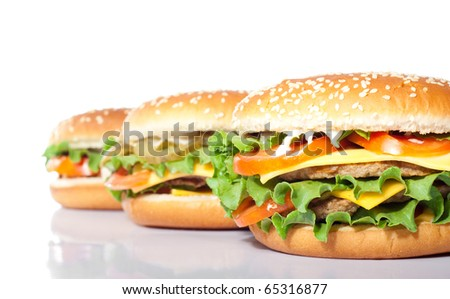 arrangement of hamburgers isolated on white - stock photo
