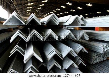Arrangement of hot-dip galvanized steel angles on the rack in warehouse before shipment - stock photo