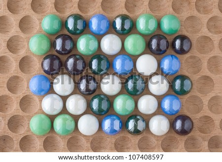 Arrangement of Marbles as Design Elements on Wood - stock photo