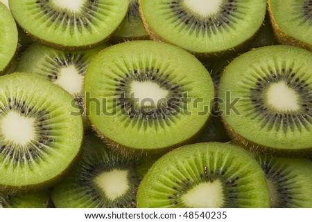 Arrangement of slices of kiwi fruit - stock photo