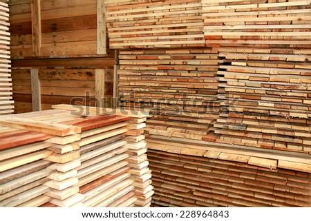 Arrangement of wooden pallet in warehouse - stock photo