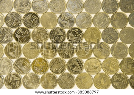 Arrays of Thai Baht money coins in golden color - stock photo