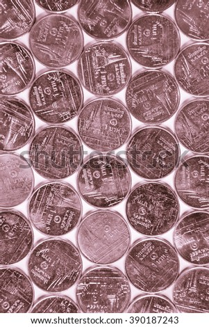 Arrays of Thai money,  one Baht coins in rose gold color - stock photo