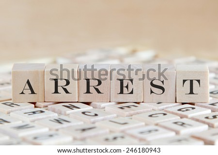 arrest word on wood blocks - stock photo