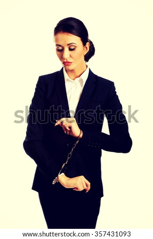 Arrested guilty businesswoman with handcuffs. - stock photo